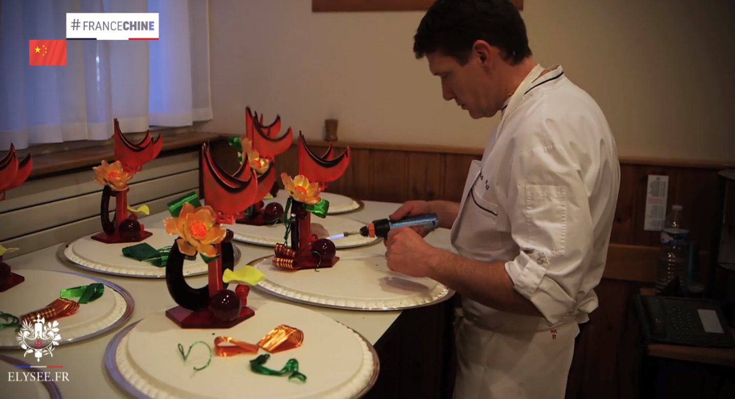 An Elysée chef preparing dessert for the meal