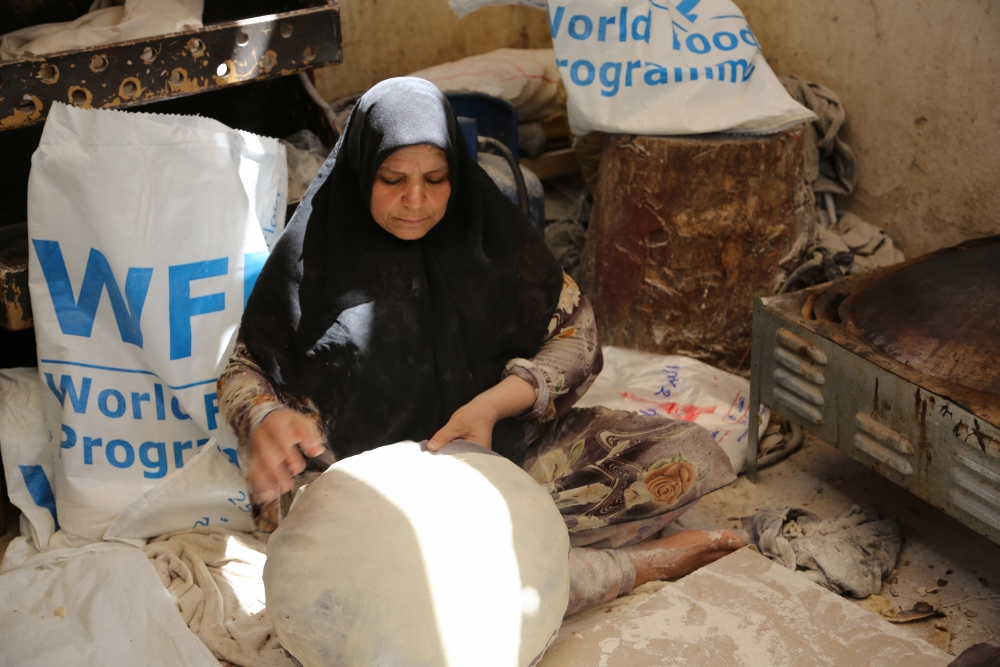 woman bread syria